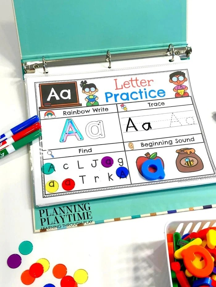 Alphabet printable in a binder with dry erase markers, clear marbles and magnetic letters.