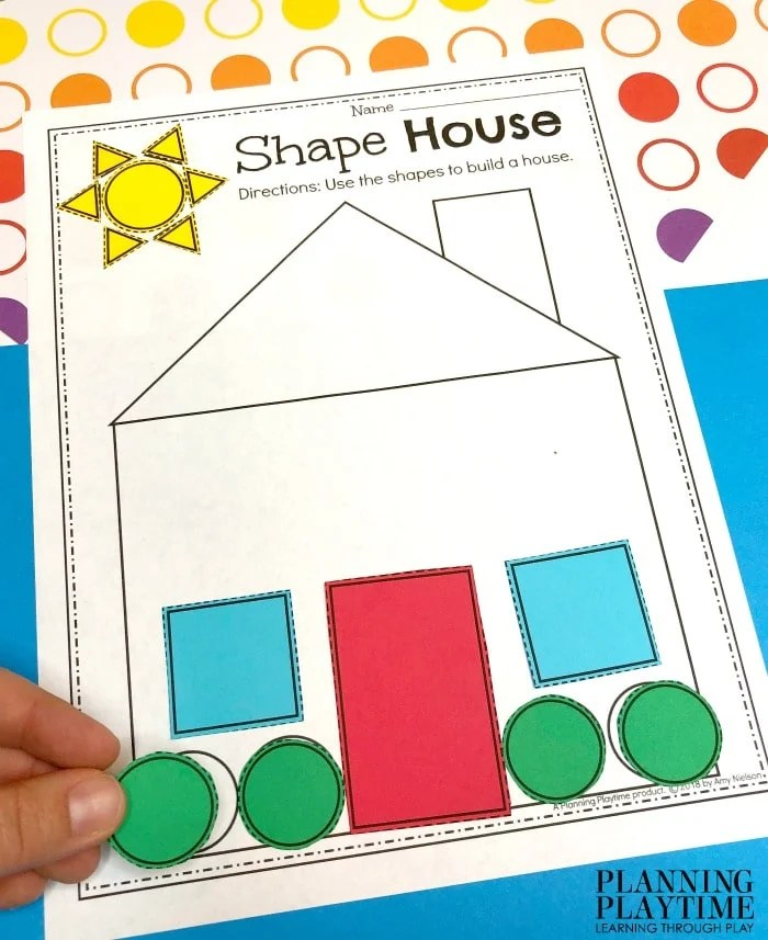 house printable with colored shapes cut out to fill in the houes spaces.