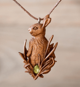 <img source = 'pic.gif' = <'Wood Pendant of Hare'/>