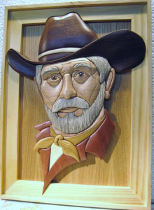 <img source = 'pic.gif' alt = 'Intarsia portrait of an old cowboy'/>