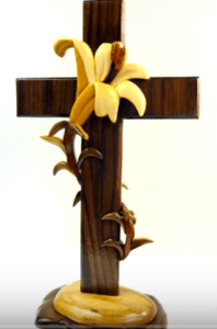 <img source = 'pic.gif' alt = 'Intarsia cross with intertwined flower'/>