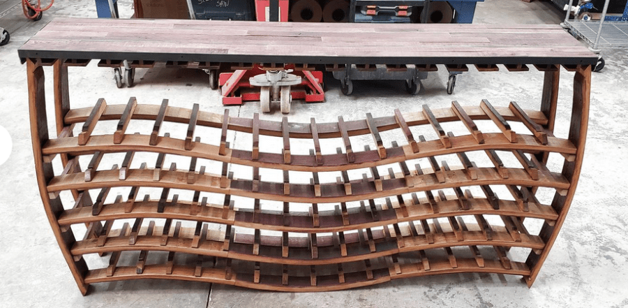 <img source = 'pic.gif' alt = 'Wine rack from barrel stave'/>