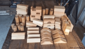 <img source = 'pic.gif' alt='Childrens wooden building blocks;/>
