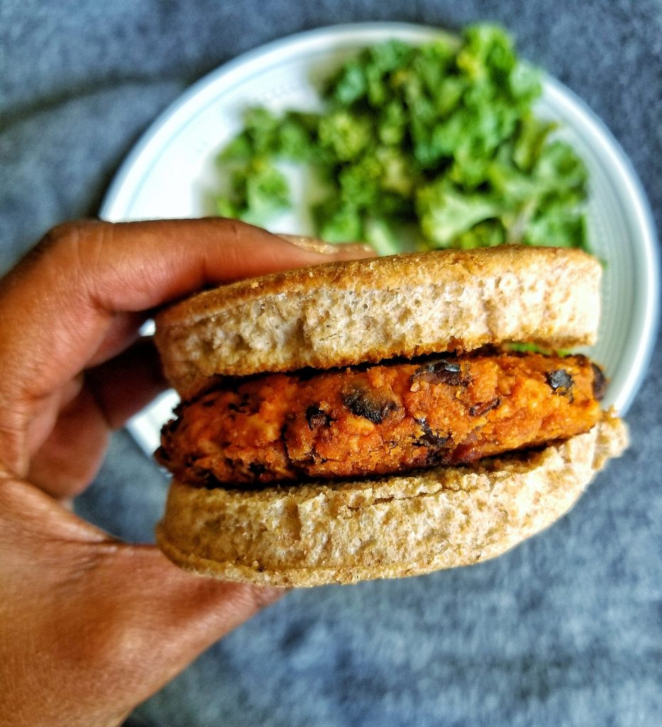 Black bean tofu burger patty between english muffins