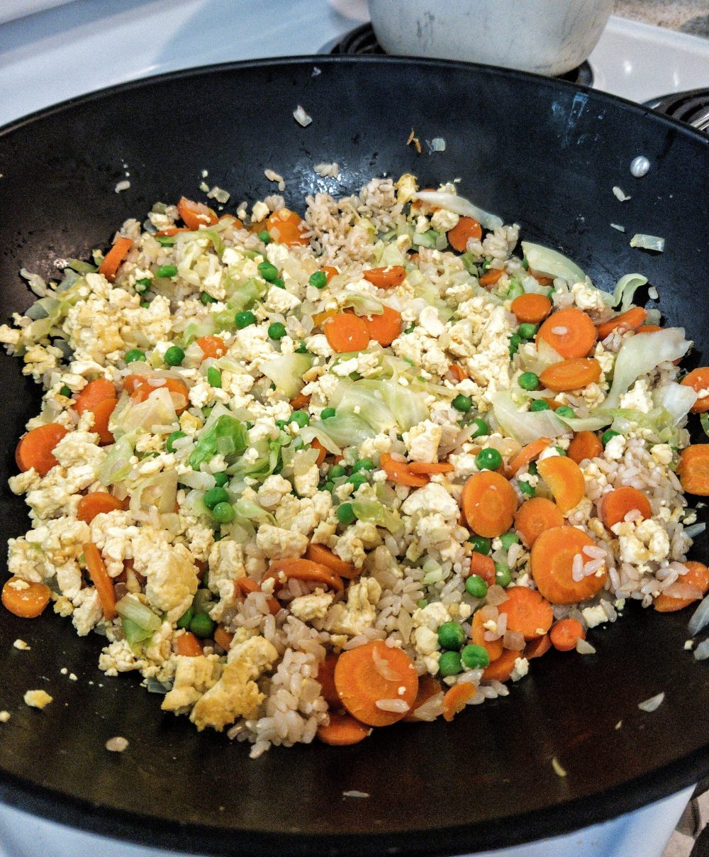 Oil-free, vegan fried rice in a non-stick wok