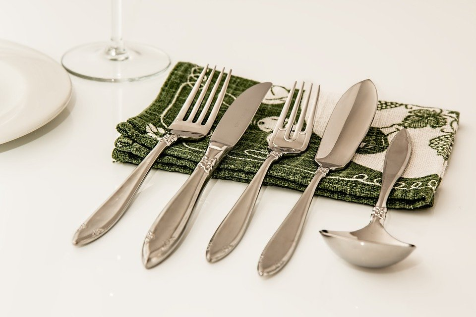 Silverware on kitchen linen
