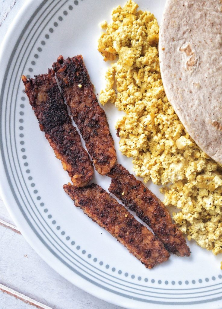 Smoky tempeh bacon with a side of tofu scramble and tortilla