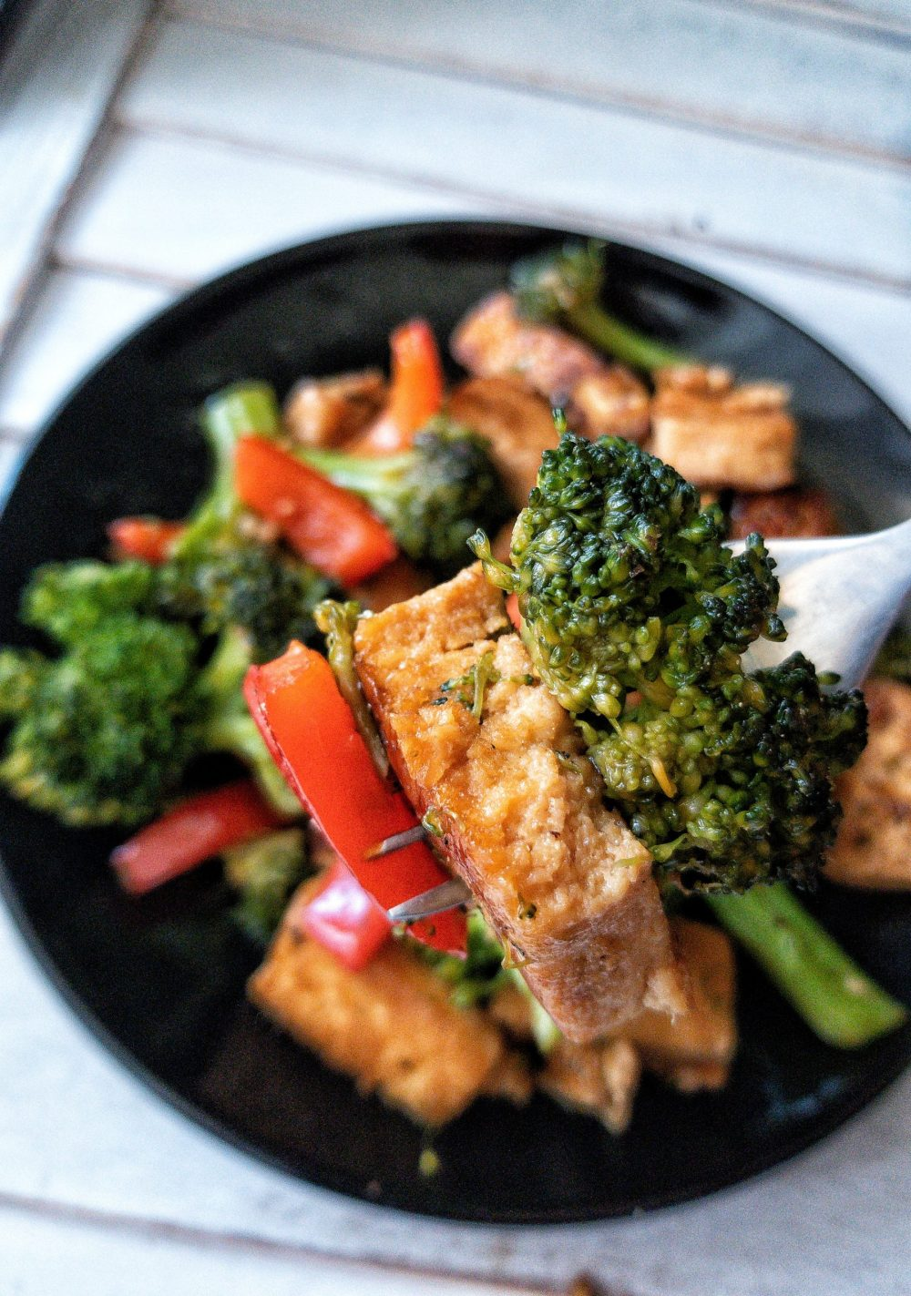 Close up of broccoli, tofu, and red bell pepper