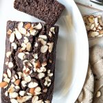 A loaf of glute free double chocolate banana bread topped with sliced almonds