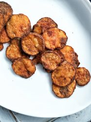 Homemade vegan baked potato chips flavored with smoked paprika and salt