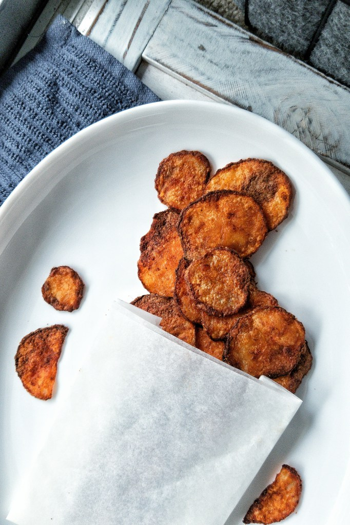 Savory and crispy chips snack seasoned with smoked paprika and salt in a paper bag