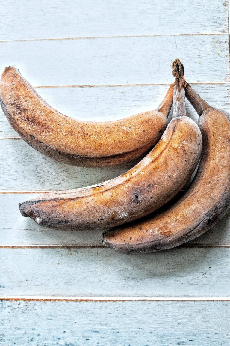 3 Frozen bananas against a blue-white background