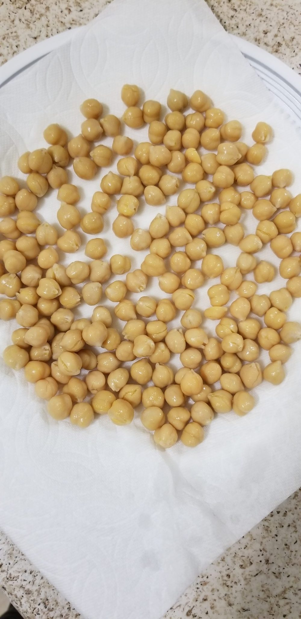 Chickpeas on a plate lined with paper towel