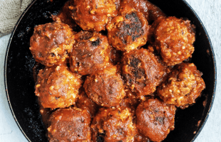 Homemade tofu meatballs in a small pan