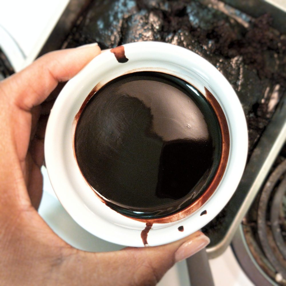 Chocolate sauce in a small white dish, closeup