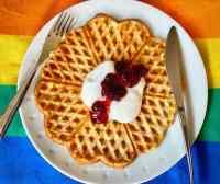 Norwgian waffles topped with fruit jam, yogurt, and cinnamon sugar