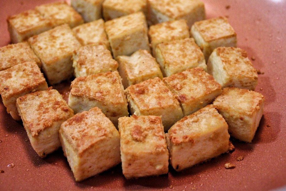 Pan-fried tofu seasoned with salt and nutritional yeast