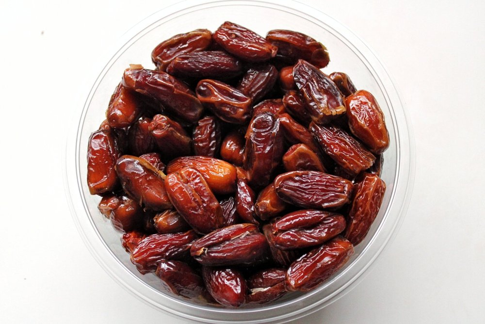 Bowl of dates in a glass bowl