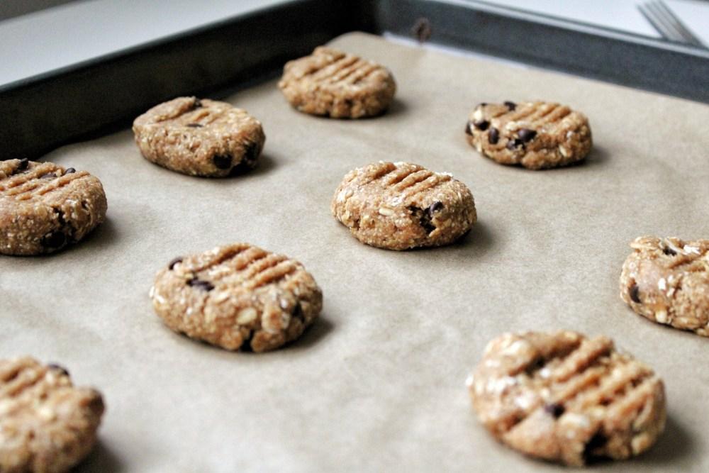Raw, vegan, gluten-free cookies on a baking tray.