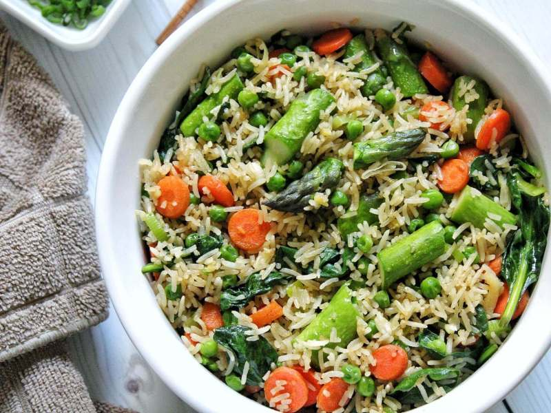Spring fried rice with asparagus, carrots, and peas