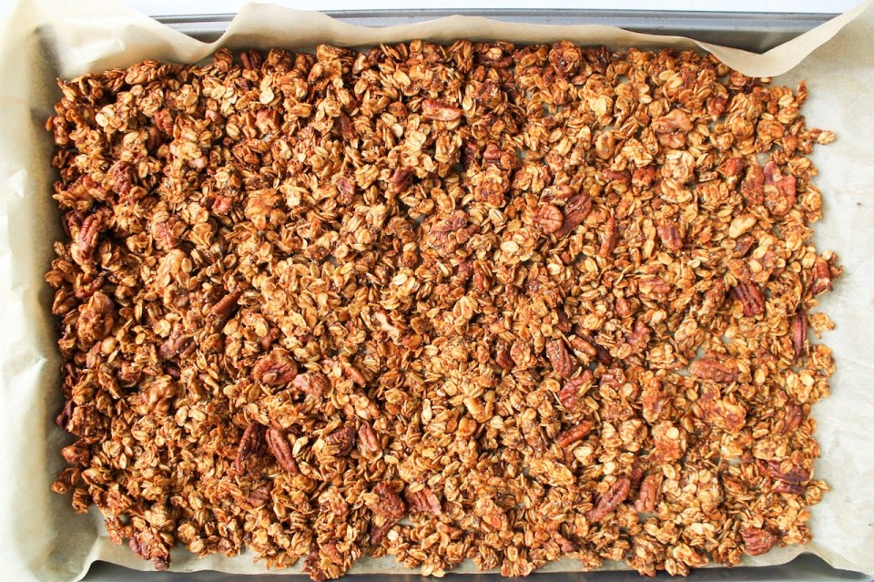 Close up on homemade granola still on the baking sheet.
