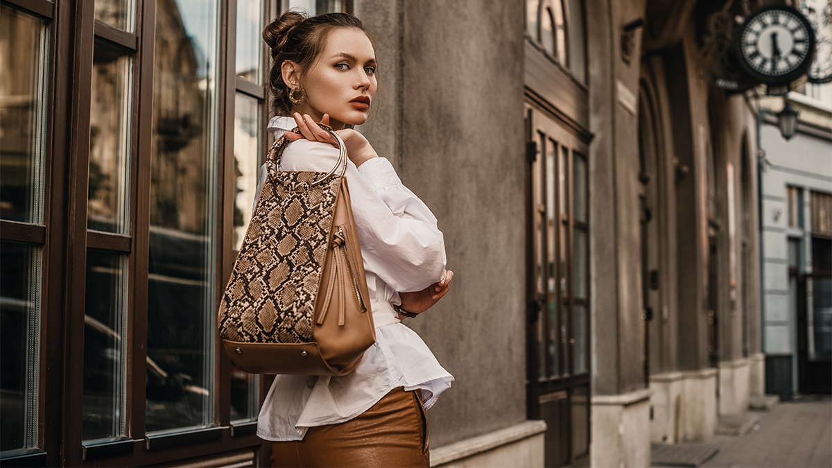Woman holding a bag made out of exotic skins
