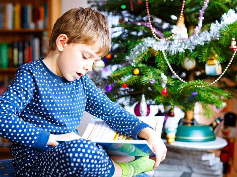 child reading book for Christmas