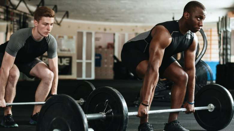 athletes weight training in gym