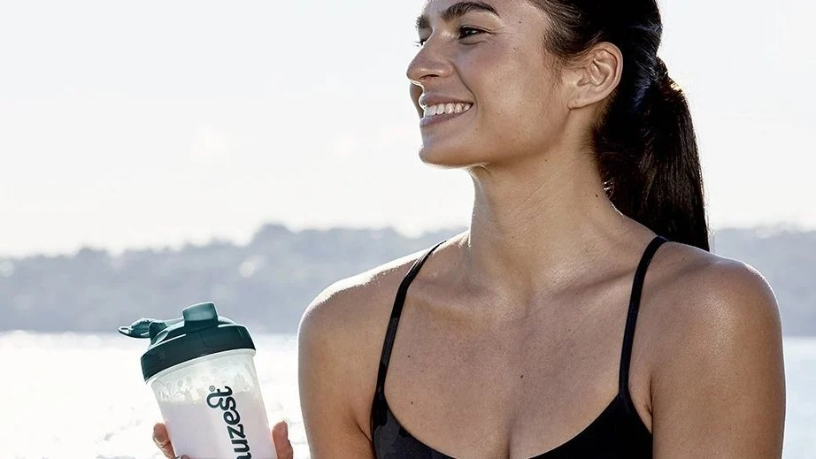 woman-holds-protein-shaker