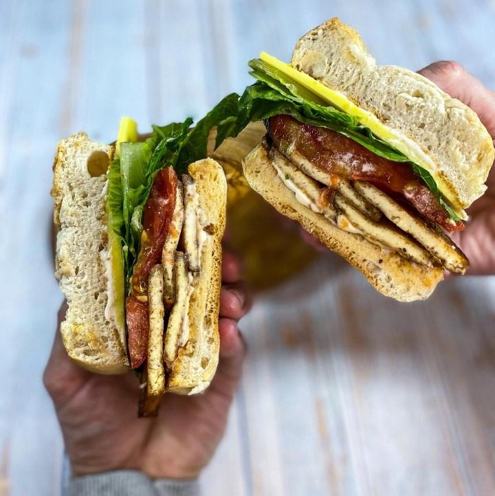 Tofu bacon in our BLT sandwich cut I half