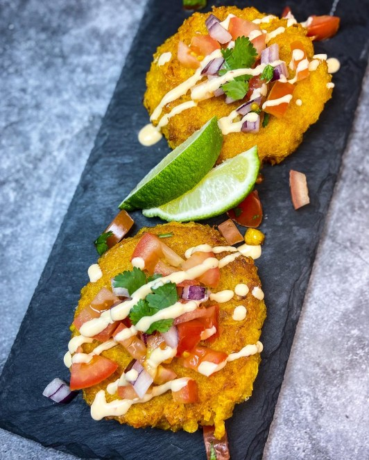 Mexican corn fritters topped with tomatoes, onions and cilantro.