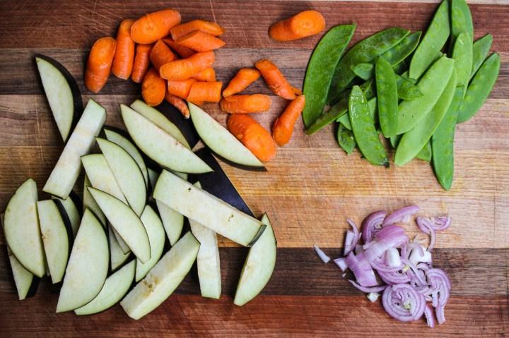 carrots snow peas onions and eggplants cut up