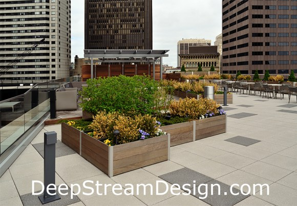 Modular custom commercial wood planters on the roof terrace of a commercial building in Boston create an outdoor dining space for tenants. Click for info