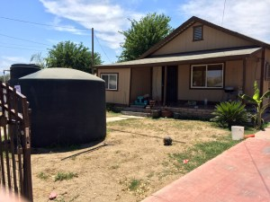 A water tank installed in an East Porterville yard provides a temporary solution during the ongoing drought.