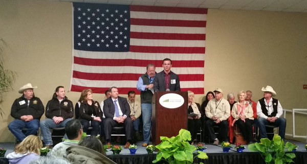CDFA Undersecretary Jim Houston (left of podium) at today's opening ceremonies for the annual World Ag Expo in Tulare.