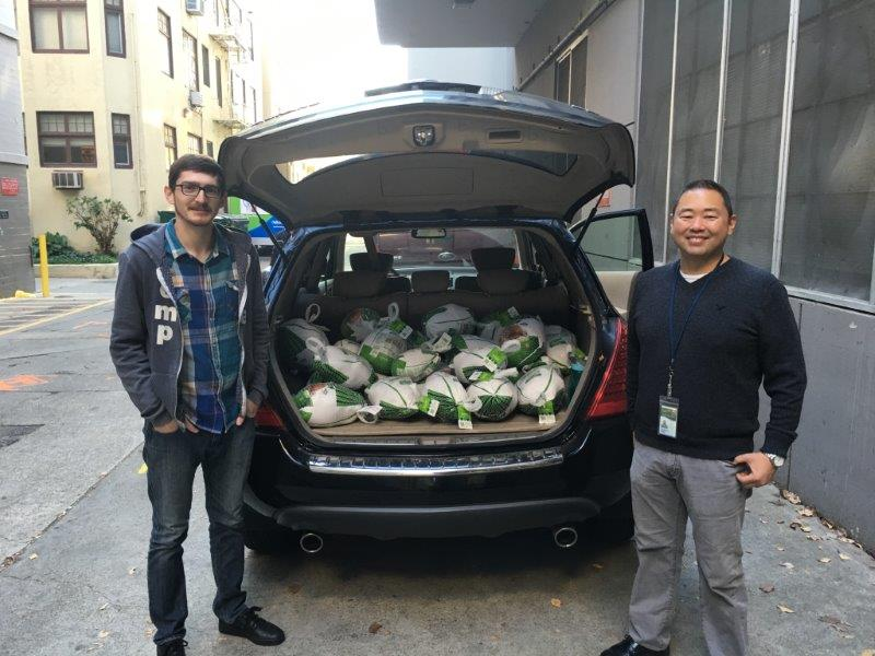CDFA employees Brandon Morrow (L) and Darrin Okimoto help load turkeys destinted to the Sacramento Food Bank and then to needy families.