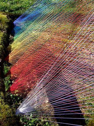 multicoloured twine in geometric pattern garden art