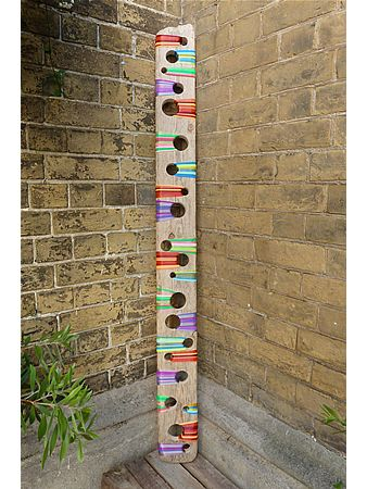 Wooden painted totem pole
