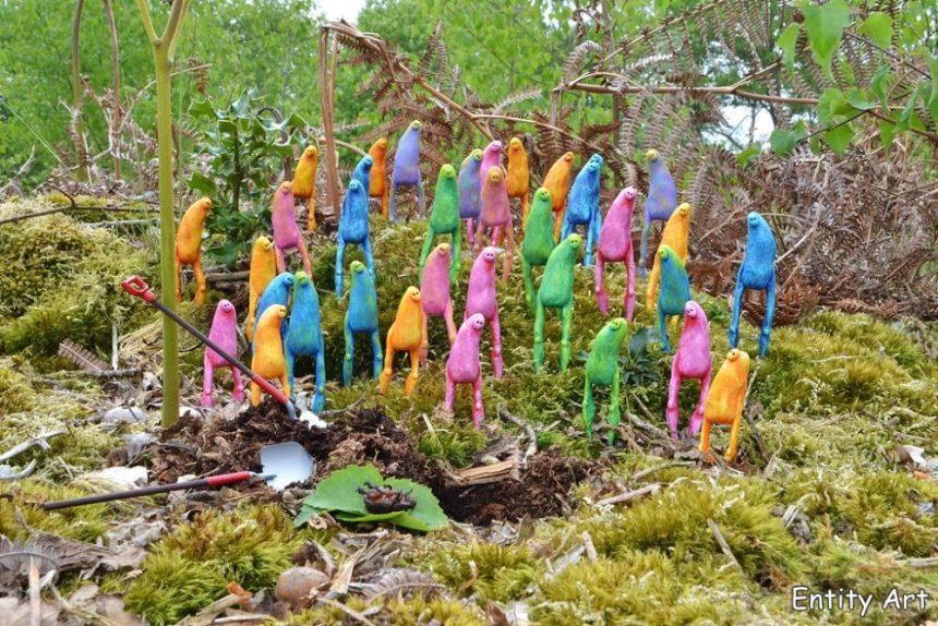 Miniature coloured figures in a garden sculpture garden art