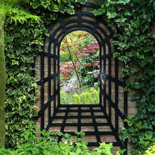 mirrot creating false window on a garden wall