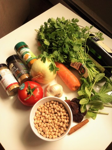 Moroccan Tagine Ingredients: Dried chickpeas with flavored with onion, carrot, garlic, cinnamon, turmeric, coriander, cumin, ginger, and cilantro