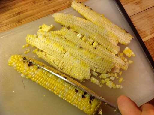 Chef's Tip: Once the corn is cool enough to handle, you can easily slice the kernels off the cob, using a sharp chef's knife. Try to keep the kernels in larger pieces for an elegant presentation with this easy salad