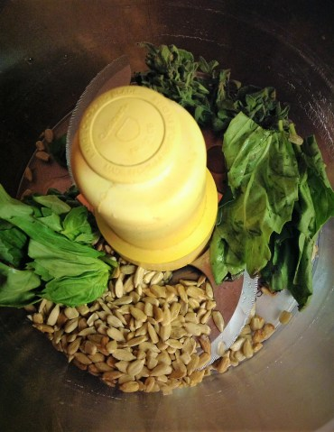 Fresh basil and oregano pair with sunflower seeds. You can use pistachios if you want more green color
