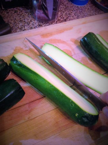 To make the zucchini boats, cut off a 1/4-inch piece lengthwise. If you cut the zucchini in half, they'll be too flimsy.