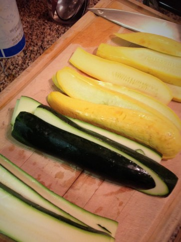 Cut the zucchini into 1/2-inch planks for grilling. This prevents the squash from falling through the cracks and makes for easier grilling