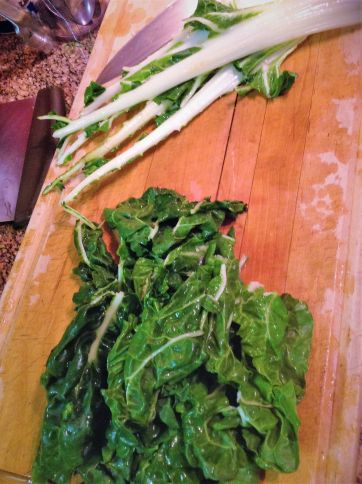 For the Swiss chard, tear the leaves away from the stalks. The stalks take longer to cook so you'll add these to the soup sooner.