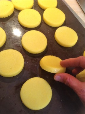 Bake the polenta disc until crispy, about 30 minutes. No need for oil or deep-frying.