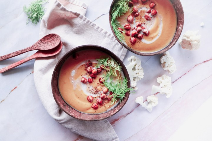 vegan cauliflower soup with roasted chickpeas and fresh herbs