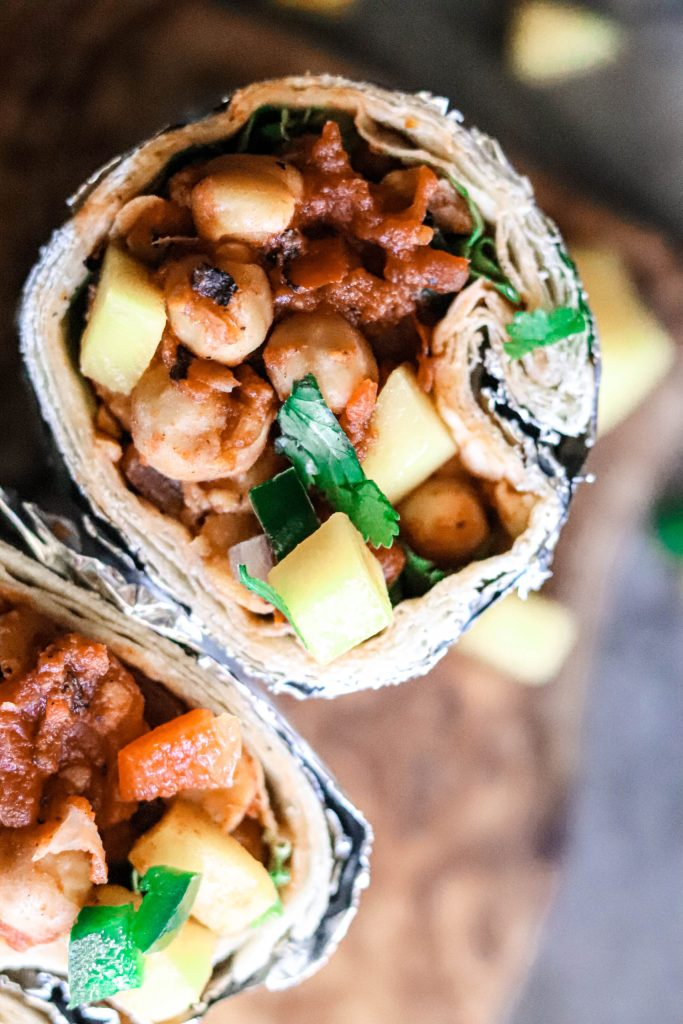 A slightly spicy mango salsa burrito with chickpeas and ready to go.