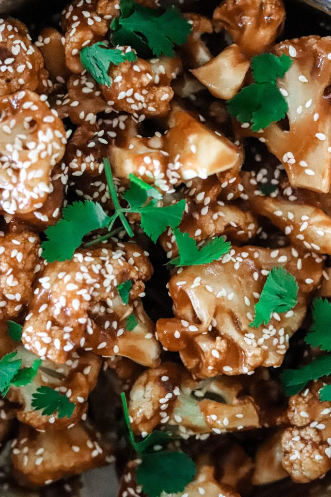 Sugar-free sweet and sour cauliflower covered into toasted sesame seeds and cilantro.